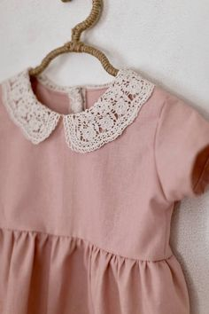 This timeless dress has an antique inspired lace collar on a blush linen fabric. It is short sleeved and has three buttons down the back. Available in sizes: (Sizes run large) 6-12 months 12-18 months 18-24 months 3T 4T Machine washable, for best results hang to dry. Made to order, usually ships in 2-3 weeks.