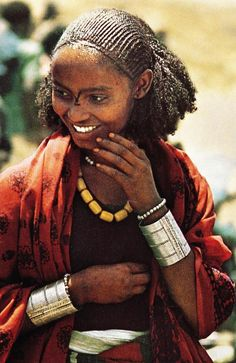"""Africa:""""Like most Ethiopians this Oromo woman from Welo Province in the central highlands, attending marking in hall her finery, is stylish without being flamboyant. Her hair dressed with rancid butter and her silver jewellery is simple in design"""" Ethiopian Hair, Ethiopian People, Ethiopian Beauty, Ethiopian Jewelry, Dress Hairstyles, African Hairstyles, Mohawk Hairstyles, Updo Hairstyle, Wedding Hairstyles"""