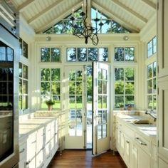 Daydreaming about dream spaces. Featuring windows, country chic style, and great light fixtures.