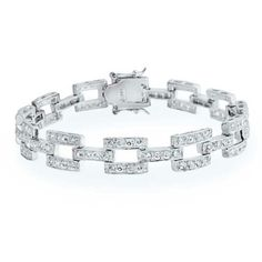 Square Link Sterling Silver CZ Tennis Bracelet Gat Measure: Will fit a 7in wrist Weight: 16 grams Material: .925 Sterling Silver, Cubic Zirconia   Price is Negotiable in reason Jewelry Bracelets