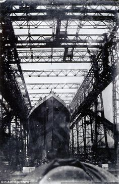 The five black and white images show the world's biggest vessel at the time sliding down a slipway and into the sea for the first time