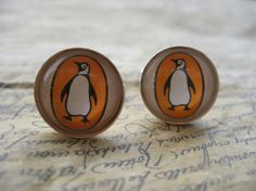 Penguin cufflinks made with the covers of vintage paperback Penguin classics.