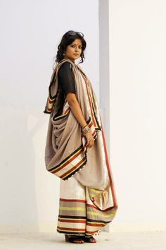 CR1311230 - Linen saree in light cofee color. Border is in gold tissue lase with maroon, neon green & black silk patti. Pleat has 20 inches lase pattern in broad tissue lase & multi color pattis. Facing is in white color block print.