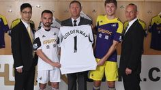 Swansea City unveil new home and away strips