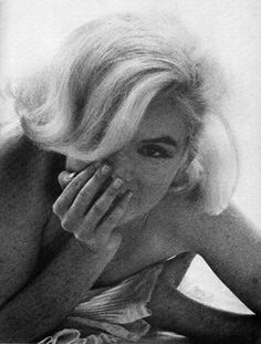 I love this photo of Marilyn. What a sexy, beautiful white and black shot of her playful side . . .