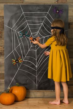 Printable pin the spider to the cobweb poster for Halloween