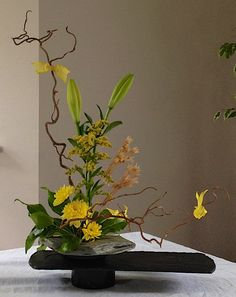 Autumn arrangement | lily, chrysanthemum, fatsia leaves, twisted willow, dried allium