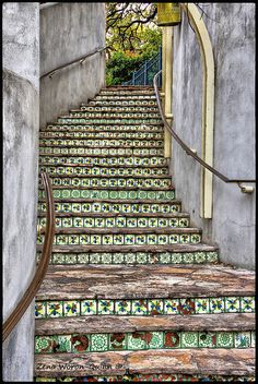 Tiled stairway.  --- not sure where it is, but it reminds me of the ones I love on the San Antonio Riverwalk... and in Santa Fe, NM.