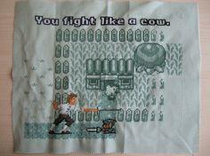 "mash-up/cross-over Zelda vs. Monkey island cross-stitch, ""You fight like a cow"". (La Ptite Bete on Sprite Stitch)"