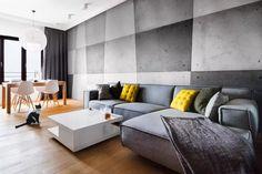 Nowoczesny salon z betonem architektonicznym