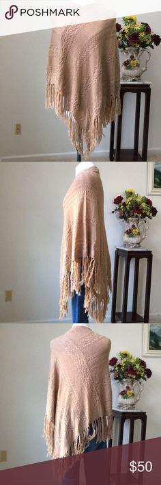 """Ralph Lauren Cable Knit Poncho-NWT Lauren Ralph Lauren cable knit poncho. High V neck with knit fringe and light weight.  The poncho has asymmetrical design.  The poncho is new with tags.  I have four colors and the wine color has the full price tag with retail price of $88.00. The tag for this poncho is cut off up to the """"Lauren"""" logo.   Holiday gift idea or something to add to your wardrobe  collection. Lauren Ralph Lauren Sweaters Shrugs & Ponchos"""