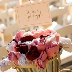 """Pink Pashmina Favors   At the entrance to the ceremony, two vintage baskets held red, pink, and white pashminas in case guests got cold. The accompanying sign read, """"Take one and get cozy."""""""