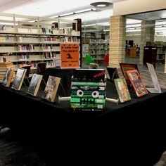 Cute Halloween book display for spooky reads. Our librarians are always coming up with the cutest displays.