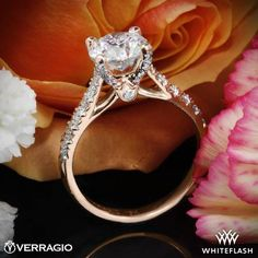This Diamond Engagement Ring is from the Verragio Couture Collection and is a less petite version of  <a href='http://www.whiteflash.com/engagement-rings/diamond-settings/verragio-4-prong-pave-diamond-engagement-ring-1804.htm'><u><b> Verragio 4 Prong Petite Pave Diamond Engagement Ring </b></u></a>.   It features 0.42ctw of Round Brilliant Diamond Melee (F/G VS) that enhance a round diamond center of your choice. Select your diamond from our extensive <a ...