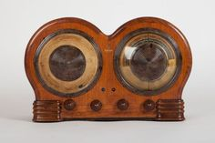 """This Art Deco Emerson """"Mae West"""" radio was designed by Count Alexis De Sakhnoffsky. This provocative design using circular shaped wood was radical in a time when rectangular tombstone radios and furniture-like consoles were stylish. No other radio made by Emerson compares to the Mae West in design. This is what makes the BD-197 quite rare today and would be the highlight of any radio collection. Radio's cabinet was made for Emerson Radio by Ingraham of Bristol, Connecticut."""