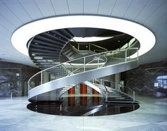 Double-helix staircase at Nestlé HQ, in Switzerland. The whole building was designed by Tschumi, and is truly, truly breathtaking.