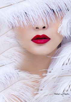 Mysterious in white feathers & red lipstick
