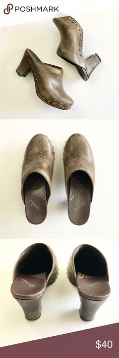 Studded leather Danskos clogs Studded leather Danskos clogs. Rich chocolate brown leather with wooden heels. Intentional leather distressed design give these a worn in and loved look. These are in good used condition with minor scuffs (pictured) Dansko Shoes Mules & Clogs