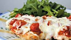 """Photo Courtesy Feeding America Easy-dinner guru Ray calls this recipe """"maybe even better than a Margherita pizza,"""" so you know it's bound to be delicious. Pizzette-Style Chicken Paillard By Rachael. Turkey Recipes, Chicken Recipes, Dinner Recipes, Low Carb Recipes, Cooking Recipes, Healthy Recipes, Chicken Paillard, Be Light, Grilled Sandwich"""