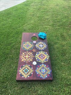 Corn hole board made with stencils by Martha Stewart and ebony paint/primer polyurethane