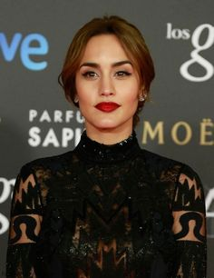 Gorgeous Megan Montaner with bold red lips at 2015 Goya Awards.