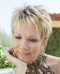 A short blonde straight coloured multi tonal spikey platinum-blonde hairstyle by Mature Web Collection