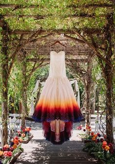 This bridal dress was handpainted by the bride herself, Taylor Ann Art. Photography by James Tang. Location: Lake Arrowhead Pine Rose Cabins.