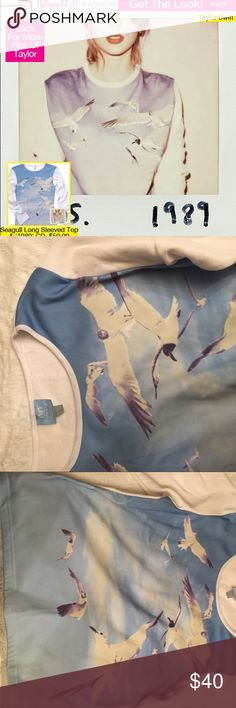 Taylor Swift 1989 Authentic Seagull Sweater Merch Excellent condition size XL Taylor Swift Seagull Sweater. She has been been seen wearing this in one of her cover Polaroid pictures. White sleeves and and all white back. Seagull print in front. 1989 collection Taylor Swift Sweaters