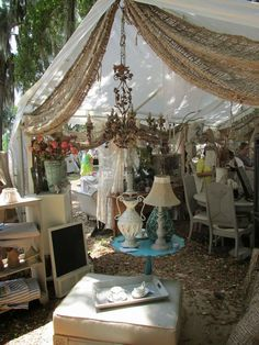 @Sue Ellen Hale I'm seeing burlap on the end of our Antique Alley tent! Look at this vintage chandelier too!  Fun flea market display.
