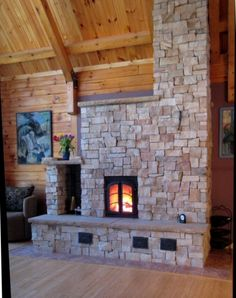 Masonry Heater. I like the rock and the door, and general shape, but I would build mine without the stair step chimney. More of a straight tower than the zig zag shape.