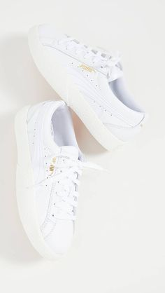 How to Clean White Sneakers: 8 Hacks to Keep Them Pristine | Who What Wear How To Clean White Sneakers, White Puma Sneakers, Leather Sneakers, Sneakers Nike, Sneakers Fashion, Sparkle Shoes, Tops For Leggings, Your Shoes, Colorful Leggings