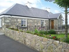 Prague House - Delightful detached stone cottage in Lettermore, County Galway. Spacious accommodation with excellent finish throughout and stunning panoramic views. Open fire and solid fuel stove. Solid Fuel Stove, Open Fires, Leiden, Prague, Ideal Home, Beautiful Homes, Cottage, Patio, Vacation