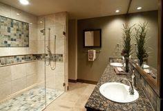 granite countertop attached with washbasin plus faucet overlooking with cubical shower plus tile floor design | Attractive and Safe Floor Tiles for Shower | https://www.designoursign.com #bathroom  #luxurybathroom #luxurybathroomideas #luxuryfurniture #interiordesign #luxurydesign #homedecor #designdetails