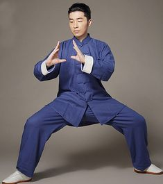 In the Wudang Mountains this particular uniform is handmade and custom tailored from devoted Taoists living in the high mountain peaks. Support the Taoists in the Wudang Mountains wit… Tai Chi, Martial Arts Clothing, Chinese Martial Arts, Qigong, Natural Linen, Kung Fu, Navy Blue, Poses, Shirts