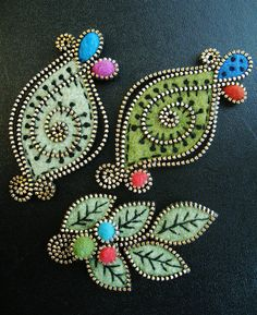 A few leaf inspired brooches by woolly  fabulous, via Flickr