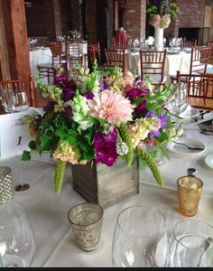 Rustic wooden boxes and lush arrangements