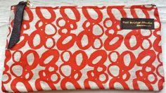 Love this orange Circles, Basic Bag. Orange with black leather zip pull