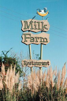 The famous Milk Farm restaurant sign in Dixon (on Highway 80, headed past Davis towards Sacramento). Via Flickr