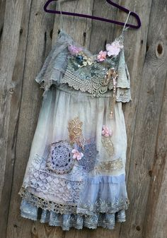 Inspired by shades of nature, antique textiles and pastel shades. The top is hand dyed in uneven shades of soft grays; the bodice part is stretchy, made of cotton jersey and rustic knitted cotton flounce overlay, the skirt part is from soft viscose, hem trimmed with various laces-