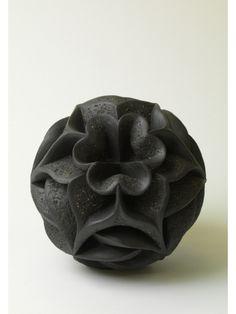 Noir by Halima Cassell Size: 23cm high Medium: Hand carved, unglazed stoneware clay