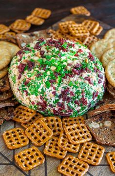 Snag some leftover cranberry sauce and swirl it into this super luxe cranberry walnut holiday cheese ball! Kick it up a notch with sprinkle of cinnamon, a drizzle of honey, and a whole lot of flavor!