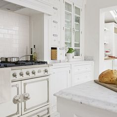 This cream range cooker by La Cornue is a statement in this white and marble kitchen.  http://www.housetohome.co.uk/kitchen/picture/bright-white-kitchen-with-cream-range