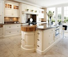 Luxury handcrafted kitchen island with integrated butchers block