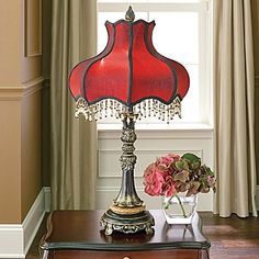 We have these with the warm ivory color shades.  Dale Tiffany Victorian Table Lamp - jcpenney