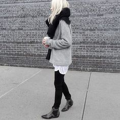 Grey sweater, black scarf, white t shirt layers.