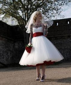 Classic wedding dress with red touches!