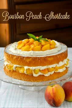 Bourbon Peach Shortcake - a light as air sponge cake gets layered with vanilla…