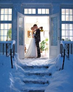 Love this bride and groom kiss during their winter wedding. Photo by Sorensen Foto