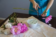 Use tape to prop up a flower arrangement.