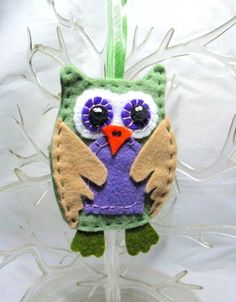 Oscar is another in my line of little felt owls for your Christmas tree.  Oscar is hand made in olive green felt with purple belly and eyes.  He is the perfect compliment to your other Christmas decor